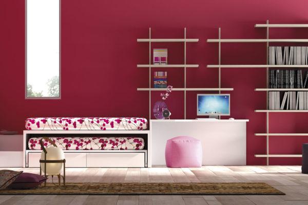 Dormitori juvenil compost per llit niu doble amb calaixos, taula estudi i prestatgeria a mida.