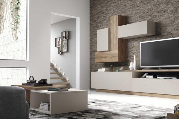 Mueble de salón moderno compuesto por módulo para televisión y zona módulos a pared formando una figura. Acabado madera natural.